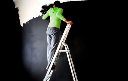woman-painting-wall-black